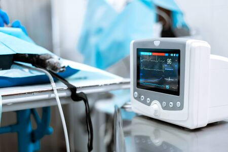 Heart rate monitor in hospital theater. Medical vital signs monitor instrument in a hospital on anesthesia surgery monitor.  ECG Patient Monitor. medical electronics. Stock Photo - 128683067