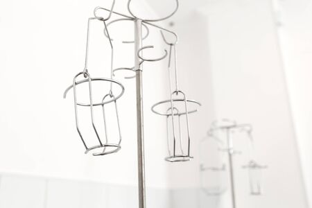 stands with a holder for drip infusion. Stock fotó