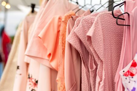 Racks with clothes outdoors. Designer sells clothes at a city fair. Stock Photo