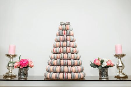 Pyramid of colorful macaroons. Sweets on the holiday. Edible decoration