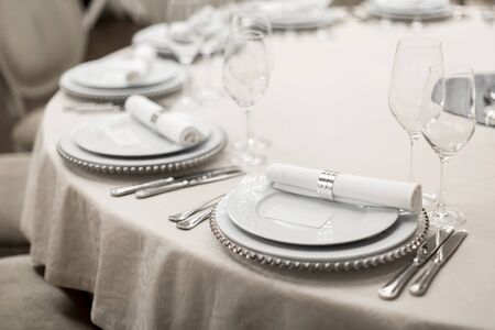 Close-up of a reserved table in a restaurant. Expensively decorated restaurant table.