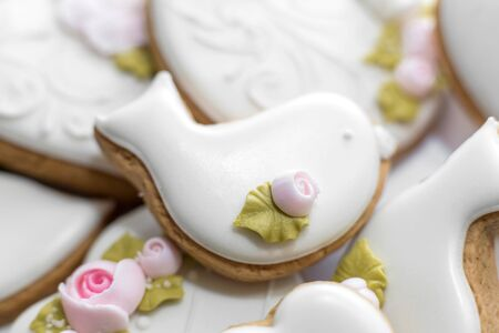 Closeup of gingerbread cookies in a white glaze. Stylish pastries as a decoration for the holidays Stock fotó