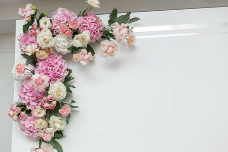Wedding decorations. Holiday decoration vase with fresh flowers near the wedding arch. Pink roses and carnations.