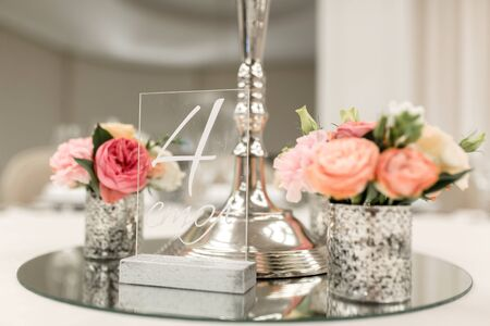 Close-up stand for a candlestick and a table number in a restaurant. Event decor.