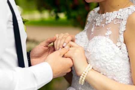 Newlywed couple in wedding dresses holding hands. Stock Photo