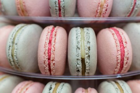 Pyramid of colorful macaroons. Sweets on the holiday. Edible decoration.