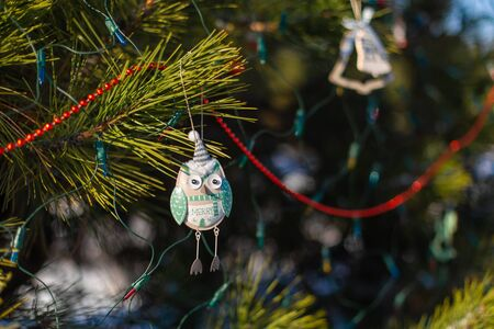 Festive decorations of a Christmas tree on the street. Close-up of branches with decorative toys. 写真素材