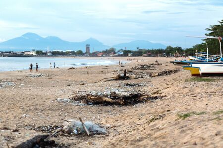 Very dirty Balinese beach with gorgeous mountain scenery.