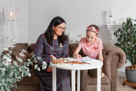 professional psychologist with a teenage girl. Disclosing a child through a drawing. The method of work of a child psychotherapist.