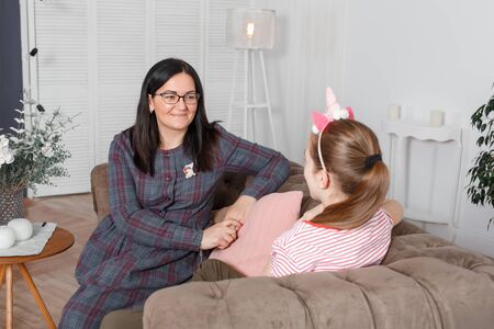 A woman is a professional child psychologist talking to a teenage girl in her cozy office. Psychological help for children. Imagens