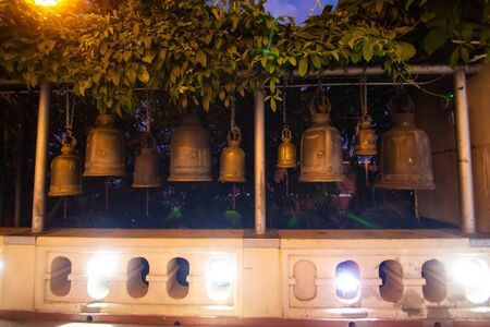 Ritual bells of different sizes in a Buddhist temple.