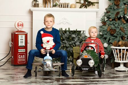 Cute two little brothers are playing with toy cars. Happy childhood