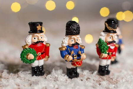 Decorative themed figurines. Toy soldiers from a nutcracker fairy tale. Festive decor, warm bokeh lights