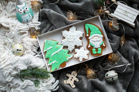 Christmas homemade gingerbread cookies and Christmas decorations. Cozy festive atmosphere.