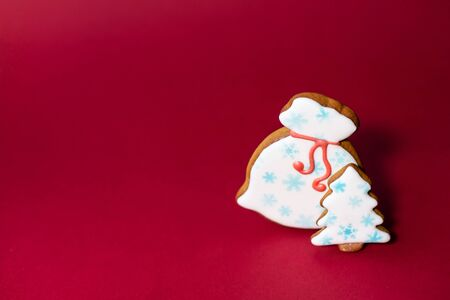 gingerbread cookie of Santas bag on red background. Traditional Christmas food. Christmas and New Year holiday concept. Copyspace.