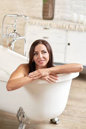 Portrait smiling gorgeous female relaxing in bath. Stock Photo