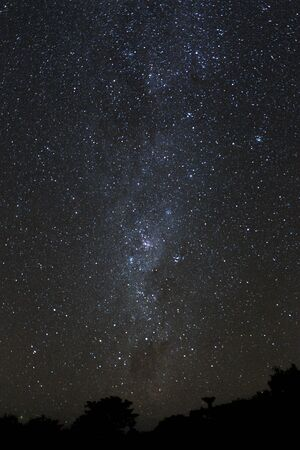 Milky Way and starry night sky over the mountains on the island of Bali.