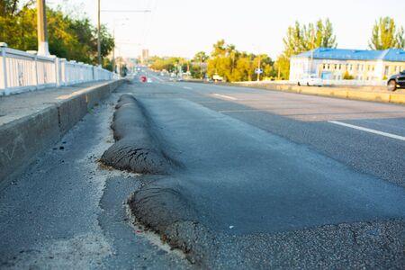 Floating substandard asphalt. Poor quality road.