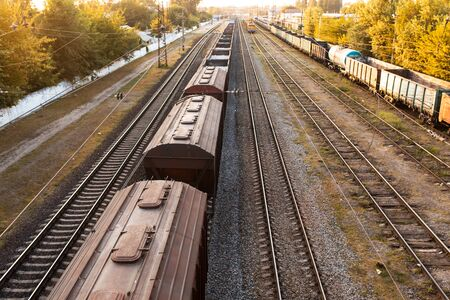 Railway. Freight wagons carrying different loads. Heavy industry concept. Stockfoto