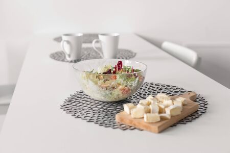 Healthy breakfast of fresh salad and cheese. Banco de Imagens