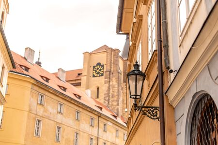The architecture of the old city of Prague. Retro gothic street lamp for street lighting. Photo in the afternoon