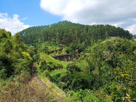 Top view of the railway in the jungle and the famous nine-arch bridge. Stock Photo