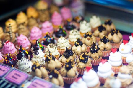 mini cakes in a refrigerated display case of a food store.