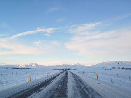 Picturesque winter landscape of Iceland. The perfect road to perspective.