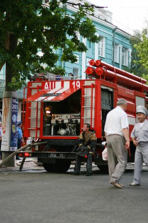 Place of incident. Fire trucks, police and military. Fire in surrender in the city center. Firefighters Work Concept.