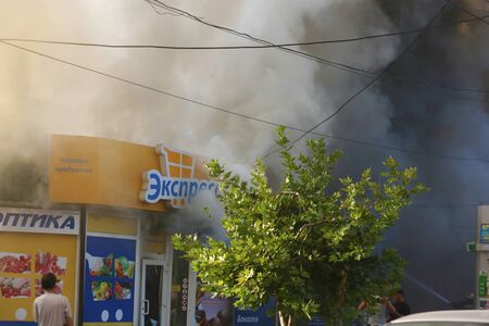 Burning building in the city. Fire extinguishing operation.