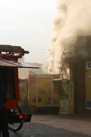 The real work of firefighters at the scene. Extinguishing a burning building. Редакционное