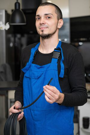 Professional window repair and installation technician holding a rubber gasket for pvc windows in his hand