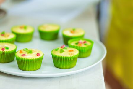 Plate with freshly baked sweet muffins. Sweet pastries, recipes, cooking. 版權商用圖片