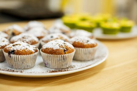 Plate with freshly baked sweet muffins. Sweet pastries, recipes, cooking.