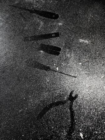 Traces of tools on a black table dusted with white dust.