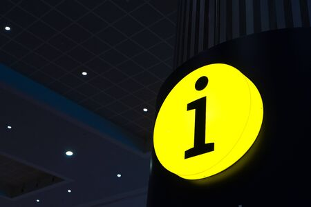 Glowing yellow sign Information desk. Reference Information. Help box. Imagens