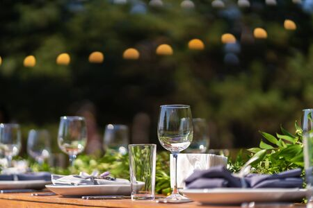 Preparing for an open-air party. Decorated served tables await guests. Decoration Details.