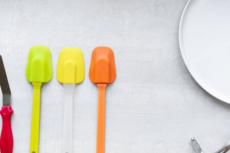 Set of multi-colored silicone spatulas, kitchen tools. Sweet pastries, recipes, cooking.