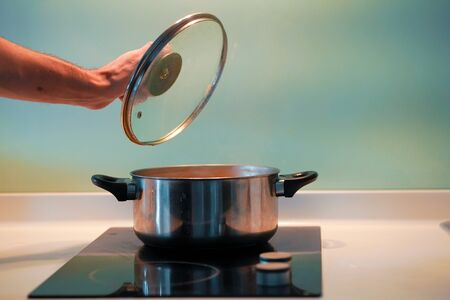 Cooking soup in a pan on an induction stove.