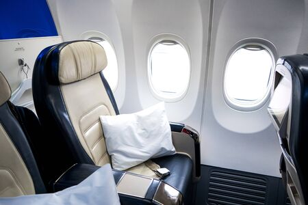 The interior of the aircraft. Empty airplane cabin. Seats for passengers in the business class compartment.