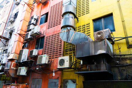 Homes in Asia hung with air conditioning. Hot climate. Narrow streets. The spirit of Asia 스톡 콘텐츠 - 149020026