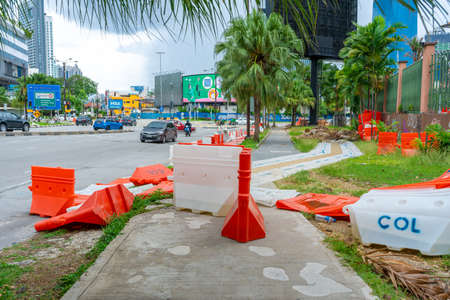 Plastic blocks restricting the passage of cars during repair work. Safe Plastic Road Fences.