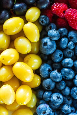 Mix of yellow and blue berries. Summer mick fruit. Berry layout.