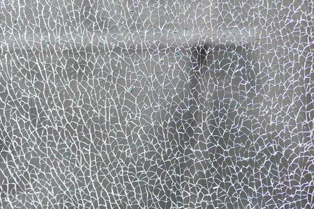Broken tempered glass. Cracked glass web.