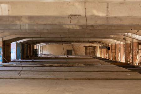 Large empty room. Concrete building. Bright space