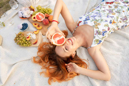 Fruit picnic with friends in the field. Stockfoto