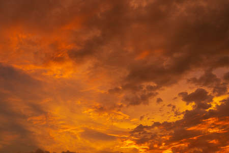 unusually beautiful fiery red tropical sunset. Burning clouds. Fire in the sky.
