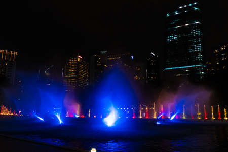 Night view of the dancing multi-colored fountains. Show of Singing Fountains.