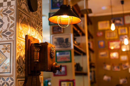Old retro rotary dial telephone in a retro-themed cafe.