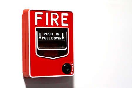 Red button handbrake fire alarm on the wall